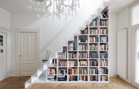 a diy bookcase in a staircase is one of many creative book storage hacks for small