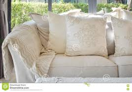 White couch pillows Blanket White Decorative Pillows On Casual Sofa In Living Room Kittenishme White Decorative Pillows On Casual Sofa In Living Room Stock Image