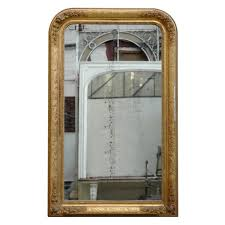 antique mirror with gilded frame and mercury glass