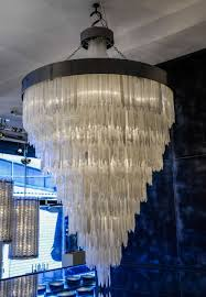 exceptional chandelier made of a metal frame and hundreds of hanging pieces of selenite mineral