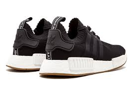 adidas nmd r1. who remembers the adidas nmd r1 \u201cgum pack\u201d from february? simple, refined aesthetic of primeknit offering paired an all black or white upper nmd