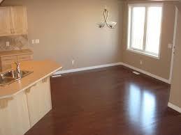 wonderful laminate flooring vs hardwood with dark brown laminated santos mahogany floor mixed white wooden kitchen