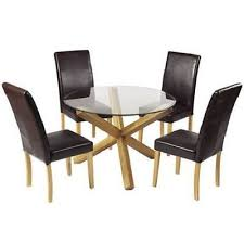 oporto dining kitchen table round clear glass solid oak legs criss cross design
