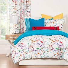 winsome crayola splat comforter set bold drips of color splashed stiching pattern of squiggles and lines solid blue reverse side superb softness of the