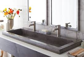 floating costco vanity with cozy trough sink and graff faucets plus sweet colorful flowers for modern bathroom design