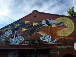 kuching street art photo essay travelnuity when you think of borneo you probably picture an island of rugged wilderness a land of rainforest and home to the endangered orangutans