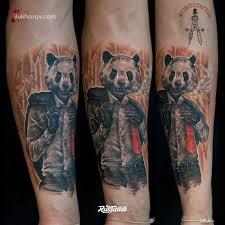 фото татуировки панда в стиле цветная татуировки на руке