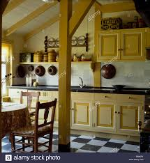 Small Fitted Kitchen Pale Yellow Fitted Units In Small Barn Conversion Kitchen With