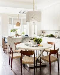 white drum chandelier with round white dining table