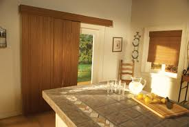sliding glass patio door built in white shutter blinds mixed with subway tiled above