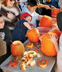 pumpkin carving tools for kids. kids carving pumpkins together pumpkin tools for