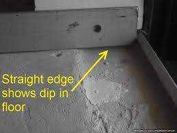 sliding glass doors need preparation for laminate flooring installation the straight edge shows the dip