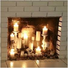 rustic faux fireplace candle display livin la vida lo living
