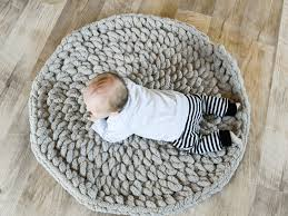 a free crochet pattern for a baby play mat that uses chunky yarn this plush