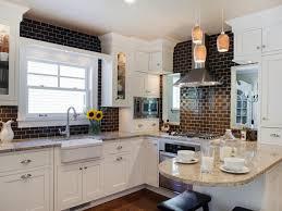 brick kitchen countertops black wooden vertical slats paneled wall rectangle white gloss kitchen island white ceramic double sink vertical glass pendant
