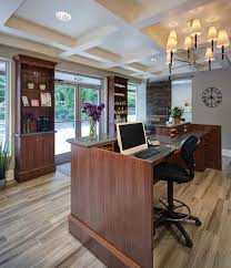 front office decorating ideas. floor to ceiling shelves like these at the back of front desk office decorating ideas