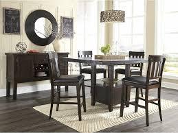 enjoy your next gathering at this extending ashley d596 haddigan dark brown pub table set