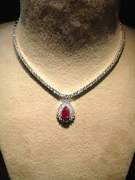 diamond pointer neckline with natural ruby pendant