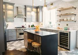 transitional kitchen wooden and tile floor concrete island metal and wood bar stools open shelves gray