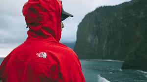 19 best waterproof jackets 2019 a man wears the north face apex jacket in red