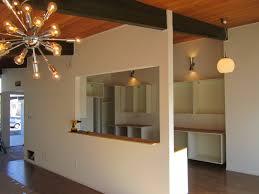 modern sputnik light fixture with mid century modern lighting in polished chrome material dinning room lighting