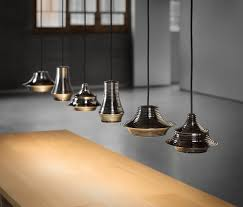 tibeta is a family of pendants with a sculptural form adding to bovers more contemporary lighting designs tibeta is a trio of pendants which compliment bover lighting