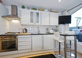 eat in kitchen furniture. small allwhite kitchen with light wood floor white cabinets against a brick eat in furniture