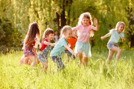 Gozon Size Chart A Group Of Children Playing And Running In The Park On A