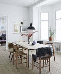 amazing minimalist dining chair my new book the scandinavian home warm furry fabric dd over these gorgeous wooden create cosiness in thi table room