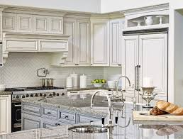 l shaped blue kitchen island with gray granite countertops