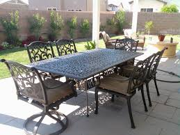 mandalay cast aluminum powder coated 7pc outdoor patio dining set with 44 x84 rectangle table antique bronze