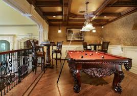 View in gallery Dramatic billiards room featuring an elegant chandelier and  rich wooden features View ...
