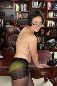 Mature Carlita Johnson milf age 33 slowly stripping in her office
