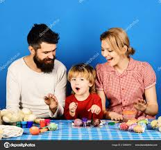 Family Prepares Colored Eggs As Easter Decorations Stock Photo