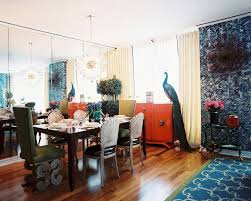 View in gallery A mirrored wall opens up an elegant dining room