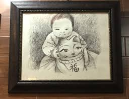 an interesting sketch of an infant and a maneki necko at the golden empress garden on south street in philly