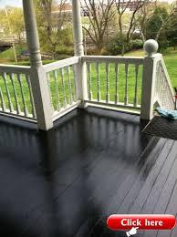 glossy black porch floor rails are