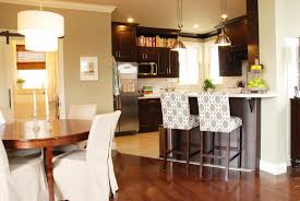 sophisticated decorative white kitchen counter stools and dark laminate floor also white and brown kitchen island