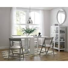designed by mark daniel this eg table is crafted of solid hardwood and engineered wood finished in white lacquer the span white eg dining table