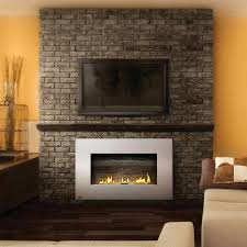 modern gas fireplace and stone wall