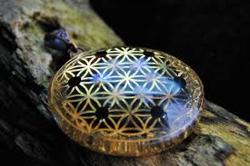 orgone pendant rainbow moonstone and onyx 24k gold flower of life iron oxide core sacred geometry high vibe gem orgonite pendant