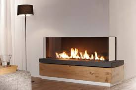 2 sided extra large gas fireplace enjoy flames from both sides right or left corner available available with a warm glowing log set white carrara