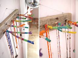 hanger jewelry holder this hanger looks stunning against a plain brick or heavy patterned wall just paint on a metallic coat and in eye hooks