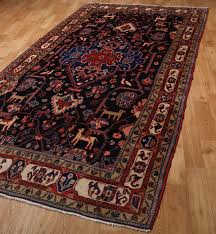 nahavand persian rug in terracotta and navy blue 157cm x 311cm
