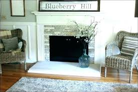 stone around fireplace for full size of faux makeover inc basement stone around napoleon horizontal gas fireplace with tv mounted