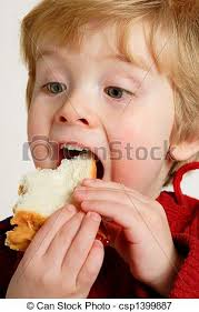 eating a peanut butter and jelly sandwich. Enjoying Peanut Butter And Jelly Sandwich With Eating