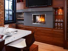 a stunning way to take the idea of warm literally is to install a kitchen fireplace