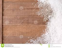 Silvery Christmas Snowflake Ornament In Snowbank On Rustic Wood ...