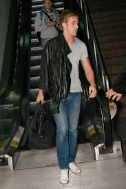ryan gosling casually slung on a handsome black leather jacket as he arrived at lax