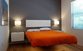 Floating bed with grey wall behind headboard